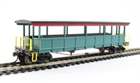 Open-sided excursion car with seats. Painted, unlettered - red, green & gold